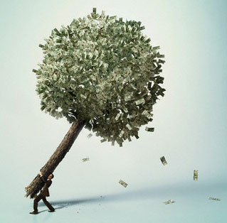 Businessman carrying money tree
