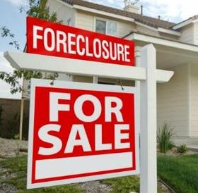 foreclosure-activity-down-realtytrac-market-report-distressed-homes-REO-filings