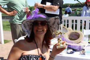 Rebecca-Litgen-with-Hats-Off-trophy