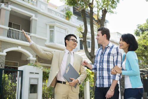 real-estate-agents-couple-showing-homes