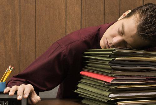 man-sleeping-agent-broker-real-estate-work